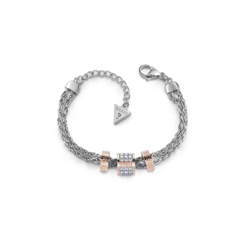 Bracelet acier avec anneau doré rose pavé de cristaux de Swarovski entouré de deux anneaux dorés rose avec logos GUESS